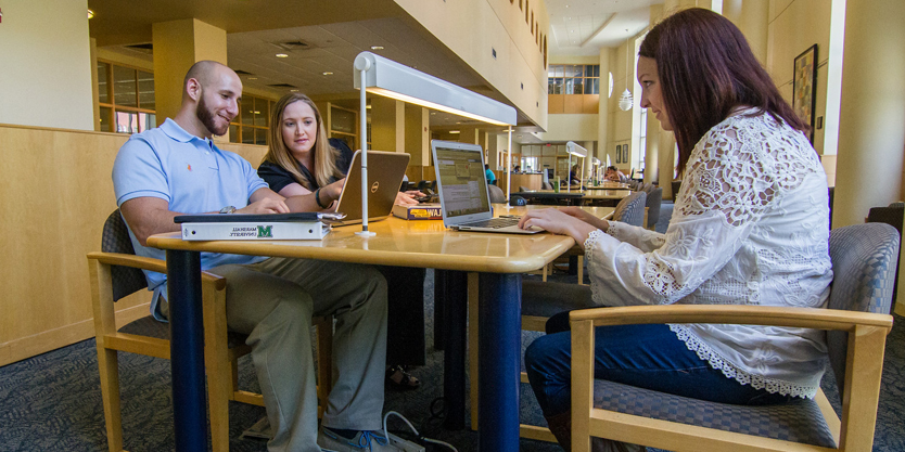 A group of students working together in Drinko Library
