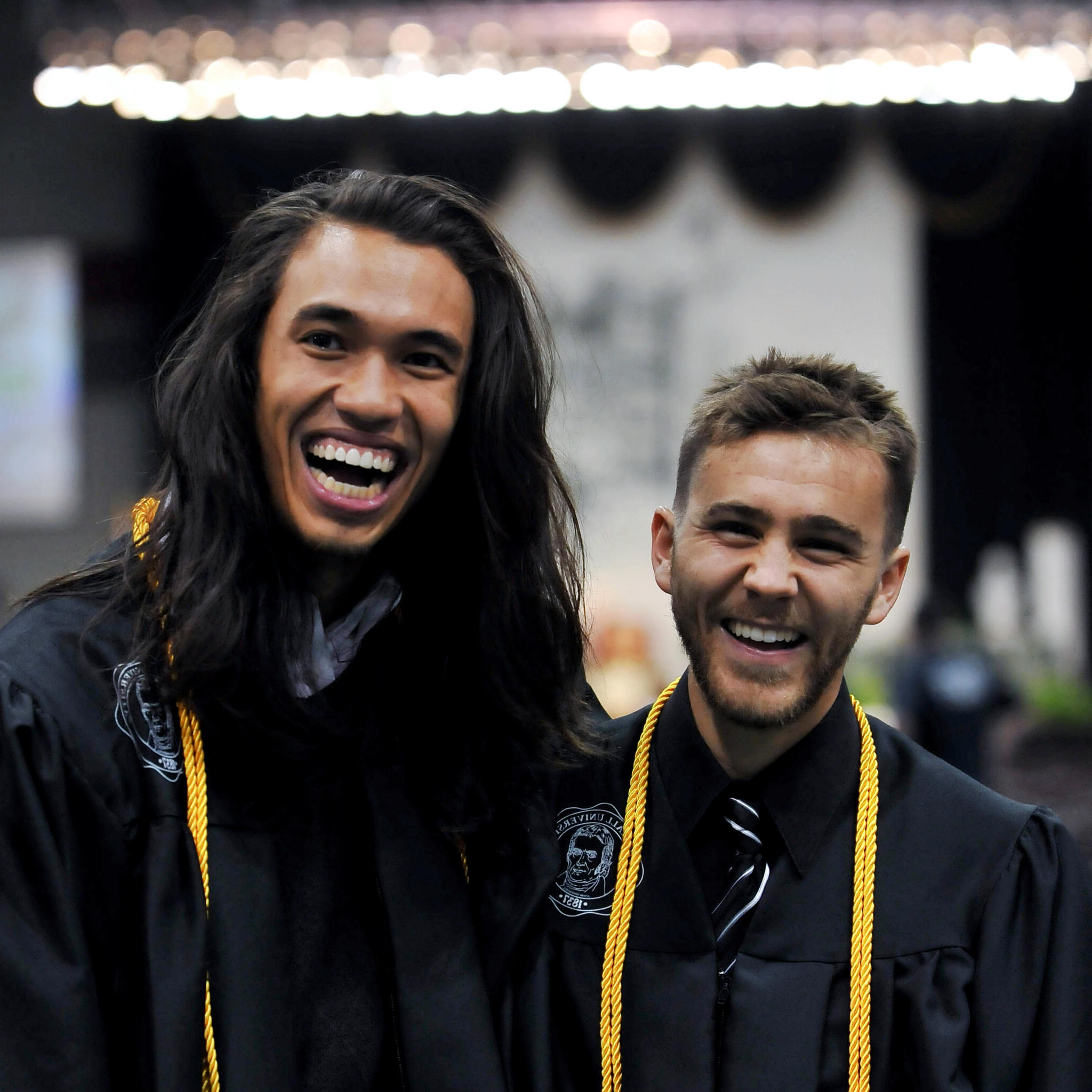 Photo of two Marshall students at commencement